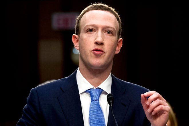 In this April 10, 2018, file photo, Facebook CEO Mark Zuckerberg testifies in Washington. Weeks after Facebook refused to remove a doctored video of House Speaker Nancy Pelosi slurring her words, Zuckerberg is getting a taste of his own medicine: fake footage showing him gloating over his one-man domination of the world.
