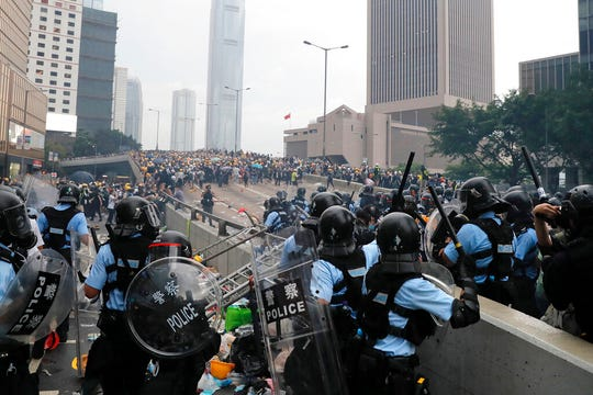 Riot police gather face off with demonstrators near the Legislative Council in Hong Kong, Wednesday, June 12, 2019.