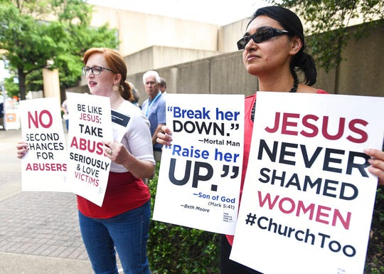 Jennifer Weed, left, and Nisha Virani, both of Birmingham, Ala., demonstrate outside Southern Baptist Convention's annual meeting Tuesday, June 11, 2019, during a rally in Birmingham, Ala. The For Such A Time As This protest calls for a change in the way the SBC views and treats women and demands action to combat sexual abuse within the establishment.
