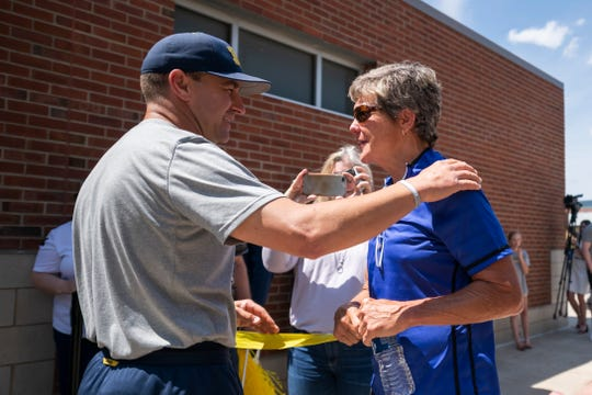 Michigan softball coach Carol Hutchins, right, chats with baseball coach Erik Bakich before the team leaves for Omaha, Nebraska for the College World Series on Wednesday afternoon.