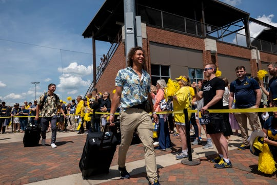 Michigan outfielder Jordan Brewer heads out to the bus after a send-off by fans held at Ray Fisher Stadium on Wednesday afternoon.
