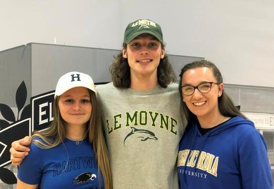 Elmira High seniors, from left, Loni Harris, Luke Baldwin and Alexa Wagner during a signing ceremony June 12, 2019 at Elmira High School.