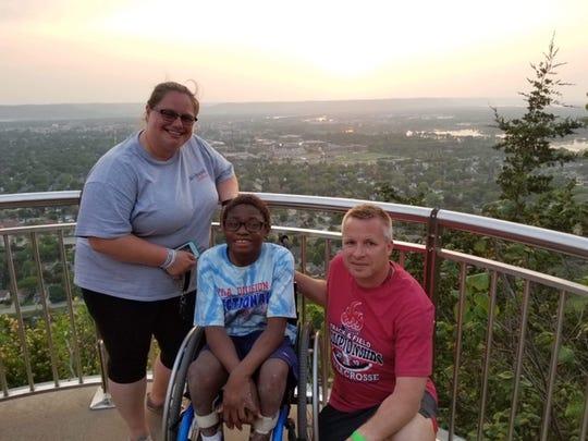 Jaylen Goodman with his mother and Coach Clark Bauer in La Crosse