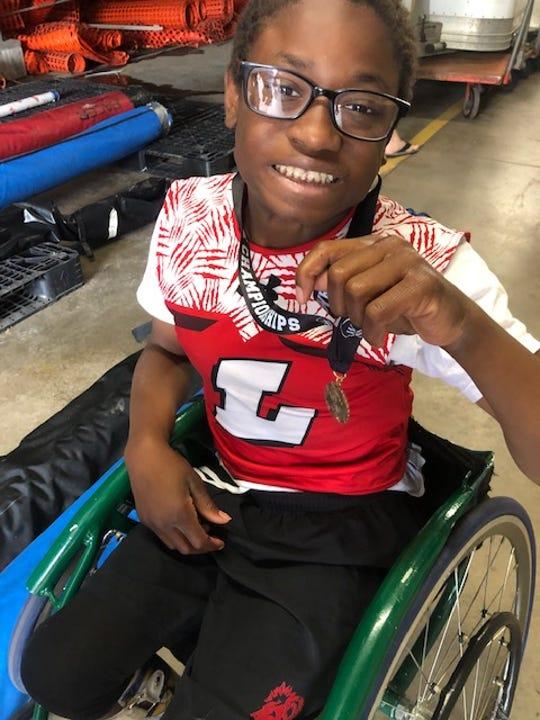 Jaylen Goodman worked with Coach Clark Bauer to train for the 100-meter wheelchair dash.