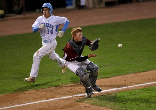 Eau Claire North's Gabe O'Brien heads home to score a run as Fond du Lac's Justin Schnell catches the ball during a WIAA Division 1 state baseball semifinal Tuesday at Fox Cities Stadium in Grand Chute.