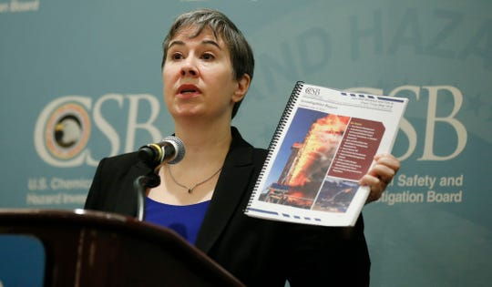 Kristen Kulinowski, interim executive director of the U.S. Chemical Safety Board, holds a copy of its report on the blowout that fatally injured five workers at the Pryor Trust gas well located in Pittsburgh County, Okla., during a news conference Wednesday, June 12, 2019, in Oklahoma City. (AP Photo/Sue Ogrocki)