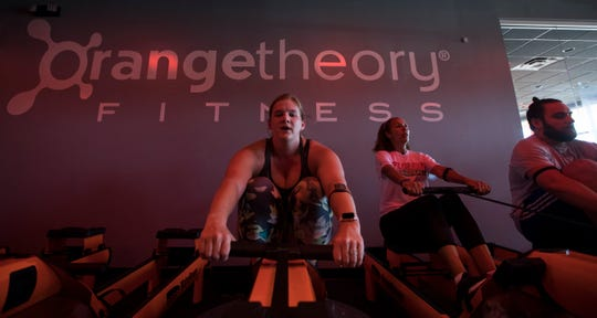 Katie Kilgore works out during a fitness class at Orange Theory Fitness in Cape Coral, June 4, 2019. The franchise recently opened its first Cape location.