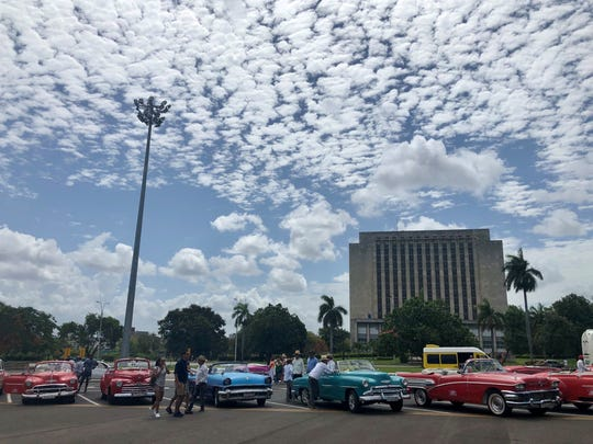 Classic cars line the Plaza de la Revolucion in Havana hoping for tourists on June 8, 2019.  The Trump administration banned cruise ships from Cuba on June 4.