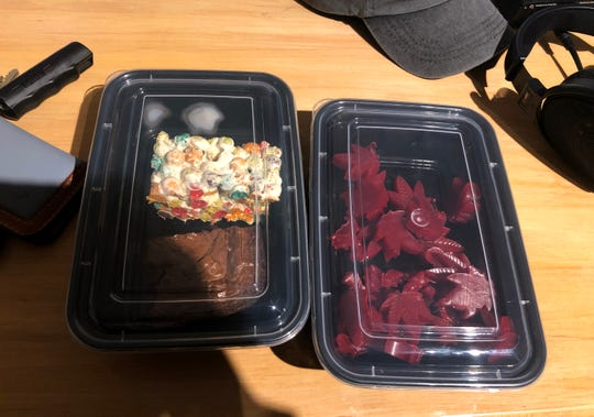 "Wisconsin Watch reporter Rachelle Wilson arranged the sale of a ""book bundle"" from BlazeMichigan, a Michigan business that sprung up after state voters legalized recreational marijuana in 2018. Sales are still banned, but enterprising entrepreneurs have devised ways to ""gift"" marijuana. In this case, edibles including a brownie, a marshmallow treat and gummies containing cannabis came free with the purchase of two used books for $65."