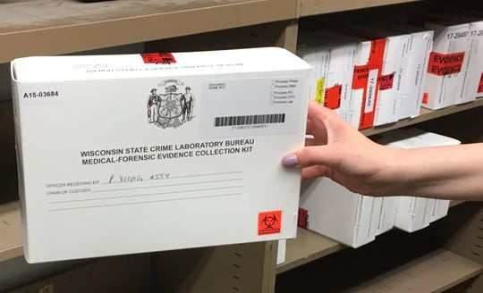 A close-up view of a rape kit, which is marked with the name of the officer assigned to the case.