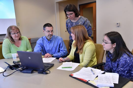 "Tom Ivacko is a policy researcher in Michigan who described 2019 as a ""haze"" as officials scrapped one process for regulating marijuana and are implementing a new one before recreational cannabis hits the streets legally, most likely in 2020. He is seen here with his team analyzing data at the Ford School of Public Policy."