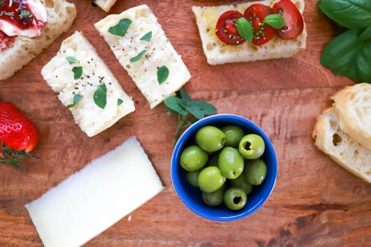 Crostini with olives, cheeses and herbs.