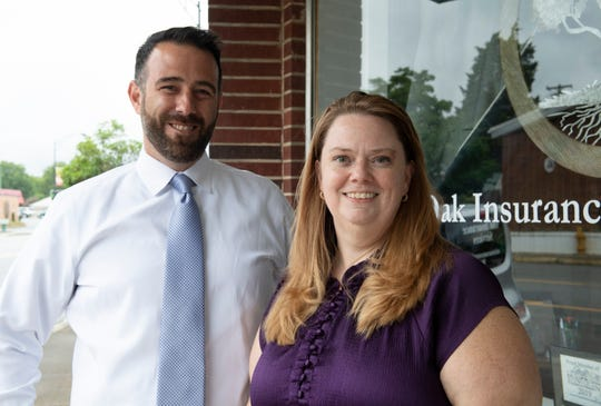 David Marino and Teri Kilgore stand outside Oak Insurance Services in Fountain Inn Wednesday, June 12, 2019.