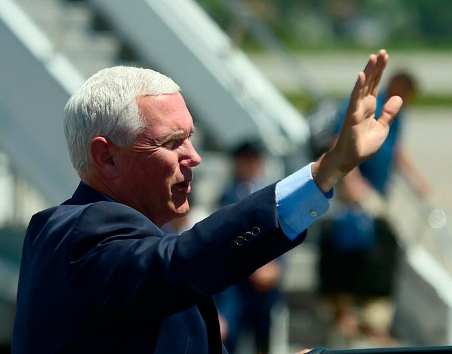 Vice President Mike Pence waves to supporters at the airport in Billings, Mont. on Wednesday, June 12, 2019. (Larry Mayer/Billings Gazette via AP)