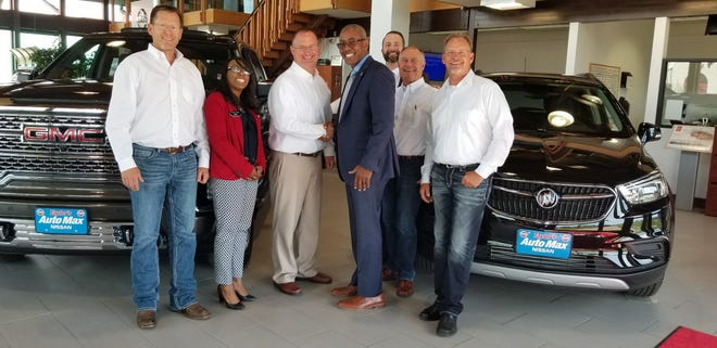 Taylor's Auto Max celebrating their purchase (from left to right: Mark Taylor, General Motors Sales Manager Lisa Gray Hunt Jim Taylor Jr., General Motors Zone Manager Michael Gordon, Dan Clowes, Jim Taylor Sr. and Mike Taylor.