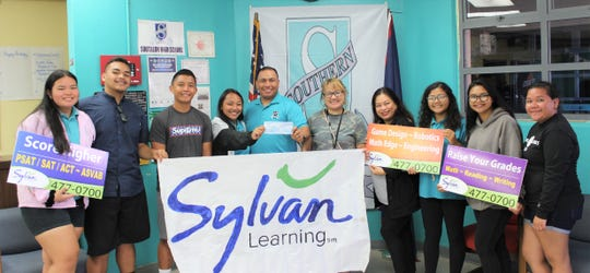 Sylvan Learning Center of Guam presented SIFA Learning Academy with an additional donation for their participation in the 2019 Lip-Dub video contest on May 23. Pictured from left: Dolores Topasna, Nathan Naputi, Eyan Saeo, Taylor Meeks, Principal Jim Reyes, Assistant Principal Dr. Darlene Roberto, Advisor Doreen Bamba, Bailey Cruz, Gerica Vegafria, and Josephine Santos. This year, Sylvan Learning Center is celebrating 30 years on Guam offering the community with personalized tutoring programs since 1989.