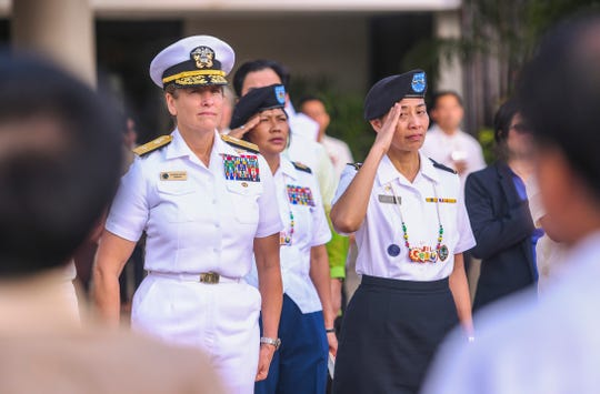 Rear Adm. Shoshana Chatfield, Joint Region Marianas commander, left, and Maj. Gen. Esther Aguigui, Guam National Guard adjutant general, join others in attendance at the Guam Reef & Olive Spa Resort's 13th Annual Flag Raising in Tumon on Wednesday, June 12, 2019. During the event, flags representing the United States, Guam and the Republic of Philippines were raised and posted, as each country's anthem was played. The ceremony, coordinated by the Philippine Consulate General's office and the resort, was held to celebrate the 121st anniversary of the proclamation of Philippine Independence Day.