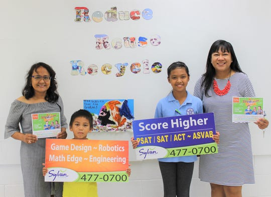 Marcial Sablan Elementary School received a donation for the winners and participants of their recycling  contest by Sylvan Learning Center of Guam. Pictured from left: Administrator Geraldine Pablo, first place winner Abraham Castro, second and third place winner Emriel Salanatin, and Janice Macatangay.