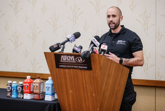 "ARM Director of Investigations, Aj Garcia, holds a press conference at the JW Marriott to speak about a newly released video by Arm, showing graphic images of alleged abuse toward sick and injured cows being milked at Fair Oaks Farms, with the title ""Operation Fairlife,"" on Wednesday, June 12, 2019."