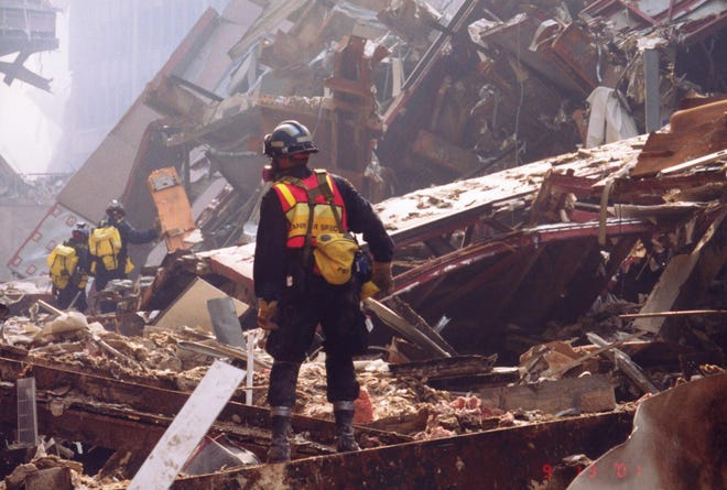 Gary Hay, canine specialist with Indiana Task Force One, surveys the remains of the World Trade Center on Sept. 13, 2001. Hay was later diagnosed with a basal cell carcinoma, a type of skin cancer covered by the Zadroga Act, related to his exposure to substances at Ground Zero.