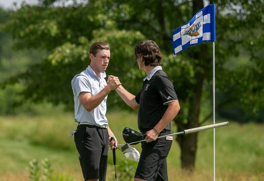 Senior from Carmel High School Nick Dentino shakes hands with senior from Noblesville High School Clay Merchent at the IHSAA boy's golf state finals at Prairie View Golf Club, Wednesday, June 12, 2019, Carmel, IN.