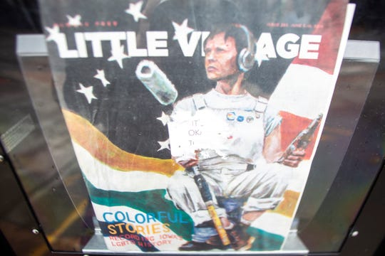 "The remnants of a sticker that read, ""It's okay to be White"" covers a window on the current issue of a Little Village Magazine newsstand, Wednesday, June 12, 2019, in Iowa City, Iowa."