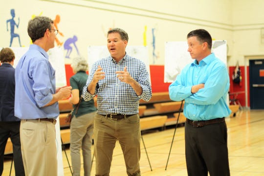 John Houghton, left, and Jason Brady, right, from Gresham, Smith and Partners Civil Engineering discuss the greenway proposals with Larsen Jay, Knox County Commissioner At-Large, at a public meeting at Halls Elementary School on June 11, 2019. The public meetings have been attended by 40-50 people on average, but in his experience, Houghton said he expects online feedback from a further 150-200 people.
