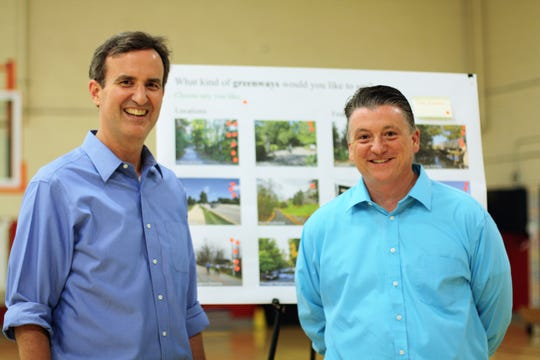 John Houghton, left, and Jason Brady from Gresham, Smith and Partners Civil Engineering were on hand to talk to the community about the proposed greenway maps and answer questions at a public meeting at Halls Elementary on June 11, 2019.