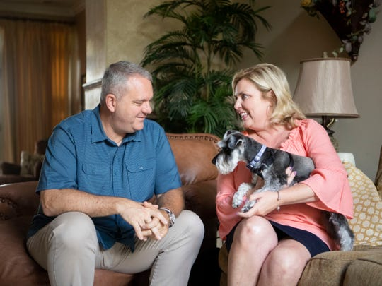 B.K. Hardin, wife Adrienne Atchley Hardin and their Schnauzer pup Rocky at their home on Sunday, June 9, 2019.
