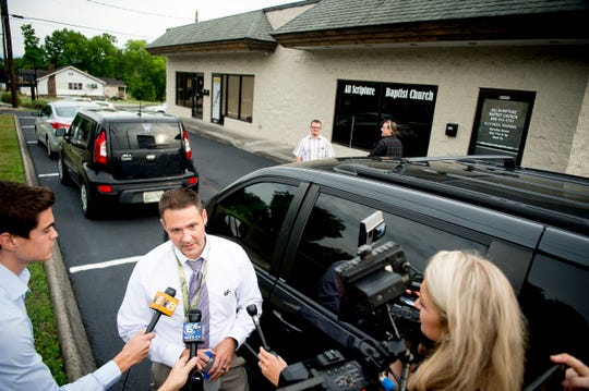 All Scripture Baptist Church Pastor Grayson Fritts, a former Knox County Sheriff's Office detective, speaks with the media ahead of the service at the church in Knoxville, Tennessee, on June 12, 2019.