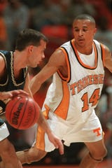 Tennessee's Tony Harris guards Wes Moore of Chattanooga during a game on Nov. 24, 1998, at Thompson-Boling Arena.