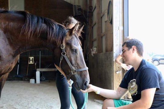 Morrison sees his horse, Dylan, for the first time since his stay at St. Vincent hospital after having surgery to amputate his left leg blow the knee in 2018.