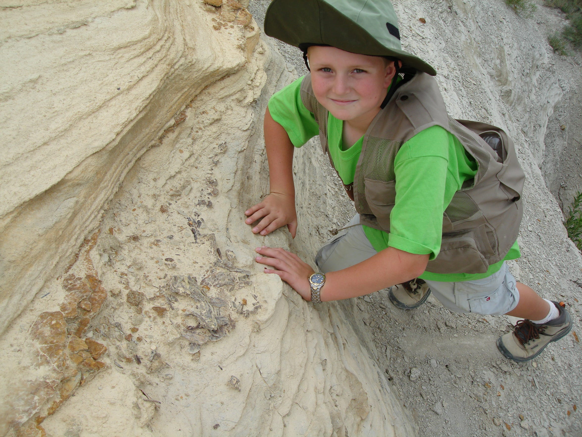 Purdue fifth-year senior forward Evan Boudreaux around age 9 in 2006, showing a fish fossil he found on one of his family's fossil dig trips.