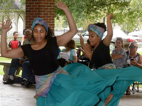 Freddie Herpin, Daily World Dance students from P.J.s Dance Art School perform a traditional dance, much to the delight of the crowd attending the annual Juneteenth Folklife Celebration held Saturday at the Farmers Market in Opelousas. The event is sponsored by Rebecca Henry and Creole Heritage, Inc.