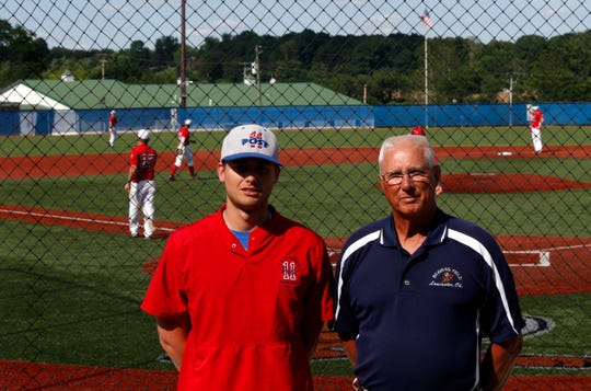 Tyler Sisson, left, and Al Beavers stand in front of the backstop at Beavers Field Tuesday, June 11, 2019, in Lancaster. Sisson and Beavers are the executive vice president and president respectively of the Fairfield County Baseball Complex Association of which Beavers Field is a part. FCBCA is trying to raise money to expand the complex with 32,000 square foot facility that would include an indoor  baseball infield, batting cages, golf tunnels and weight room. The new facility would be built on the same property as Beavers Field.