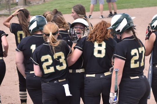AJ Militello is mobbed at home plate after hitting her 17th home run of the season to tie the game, 1-1, in the first inning of a 9-1 victory over Canton in the state quarterfinals at Chelsea on Tuesday, June 11, 2019.