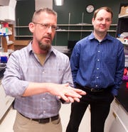 University of Louisville Biology Department Assistant Chairman Dr. Michael Menze talks about the blood drying process, left, as University of Louisville Assistant Professor of Bio-Engineering Dr. Jonathan Kopechek listens, right.