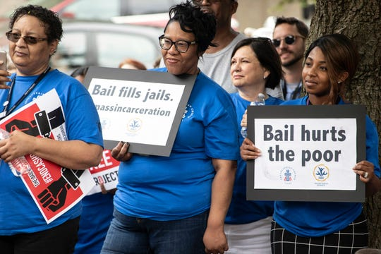 Hoisted signs defined the theme of a rally in Jefferson Square on Wednesday as Bail Project supporters advocated for reform in the American cash bail system.  June 12, 2019