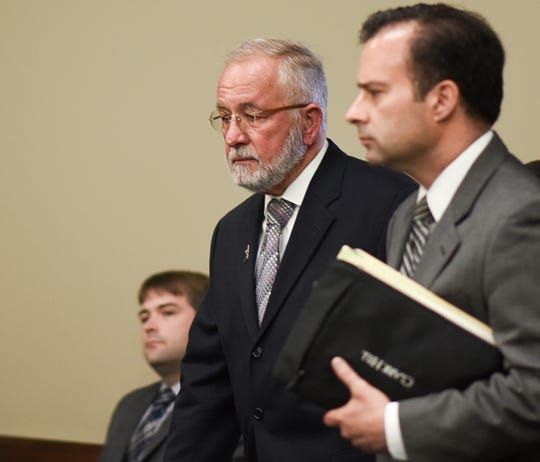 William Strampel, left, former dean at the College of Osteopathic Medicine at Michigan State University in East Lansing, Michigan, enters Ingham County Circuit Court  Wednesday, June 12, 2019, with his attorney John Dakmak.  The jury found him guilty of misconduct in office, and on two charges of willful neglect of duty related to the Nassar scandal.  He was found not guilty of sexual assault.
