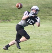 Clear Fork's Caden Flynn, who averaged a gaudy 32 yards per catch last season, snags a pass during the South's all-star practice Tuesday at Lexington High School.