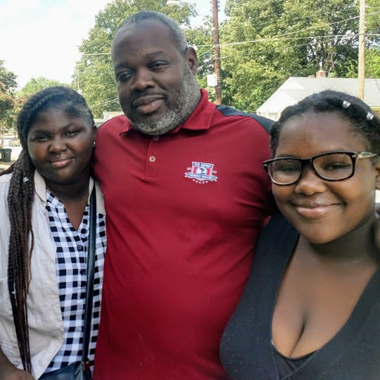 Larry Wilson and his daughters.