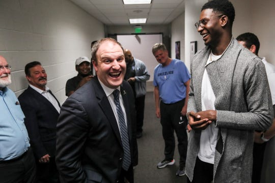 Taylor Jenkins, the Memphis Grizzlies new head coach, left, and Jaren Jackson Jr., right, after a press conference at the FedExForum on Wednesday, June 12, 2019.