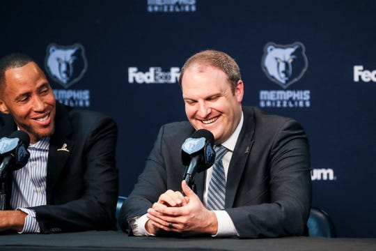 Taylor Jenkins, the Memphis Grizzlies new head coach, right, smiles during a press conference at the FedExForum on Wednesday, June 12, 2019.