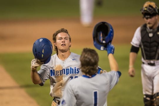University of Memphis junior Alec Trela is congratulated by teammate Cale Hennemann after hitting a home run against UCF in the 2019 American Athletic Conference Tournament at Clearwater, Fla. on May 22.