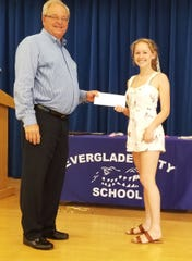 Samantha Bruscini from Everglades City receives a scholarship from Craig Woodward.
