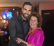 """Actor Tim Hughes of Brookfield smiled with his mom Karen Hughes during the viewing party during the Tony Awards on June 9 in New York City. Hughes is part of the """"Hadestown"""" cast which won best musical."""