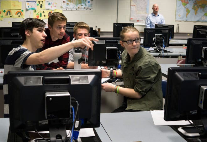 Students in an AP Computer Science A class at Hortonville High School work on a problem as a team as they review for their exam in early May. From left: Archer Lorenz, John Wirth, Jake Krause and Grace Vanden Heuvel.