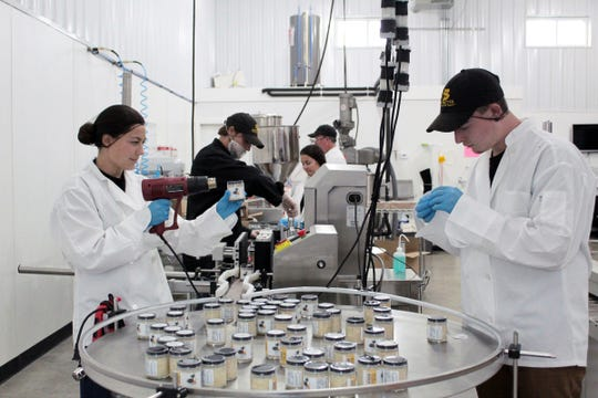 Kayla O'Leary (left) and Levi Budz work on the production of Budz Butter products in Suamico.