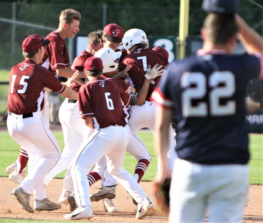 Fond du Lac players celebrate their walk-off win over Brookfield East in Tuesday's WIAA Division 1 state quarterfinal game at Fox Cities Stadium in Grand Chute.