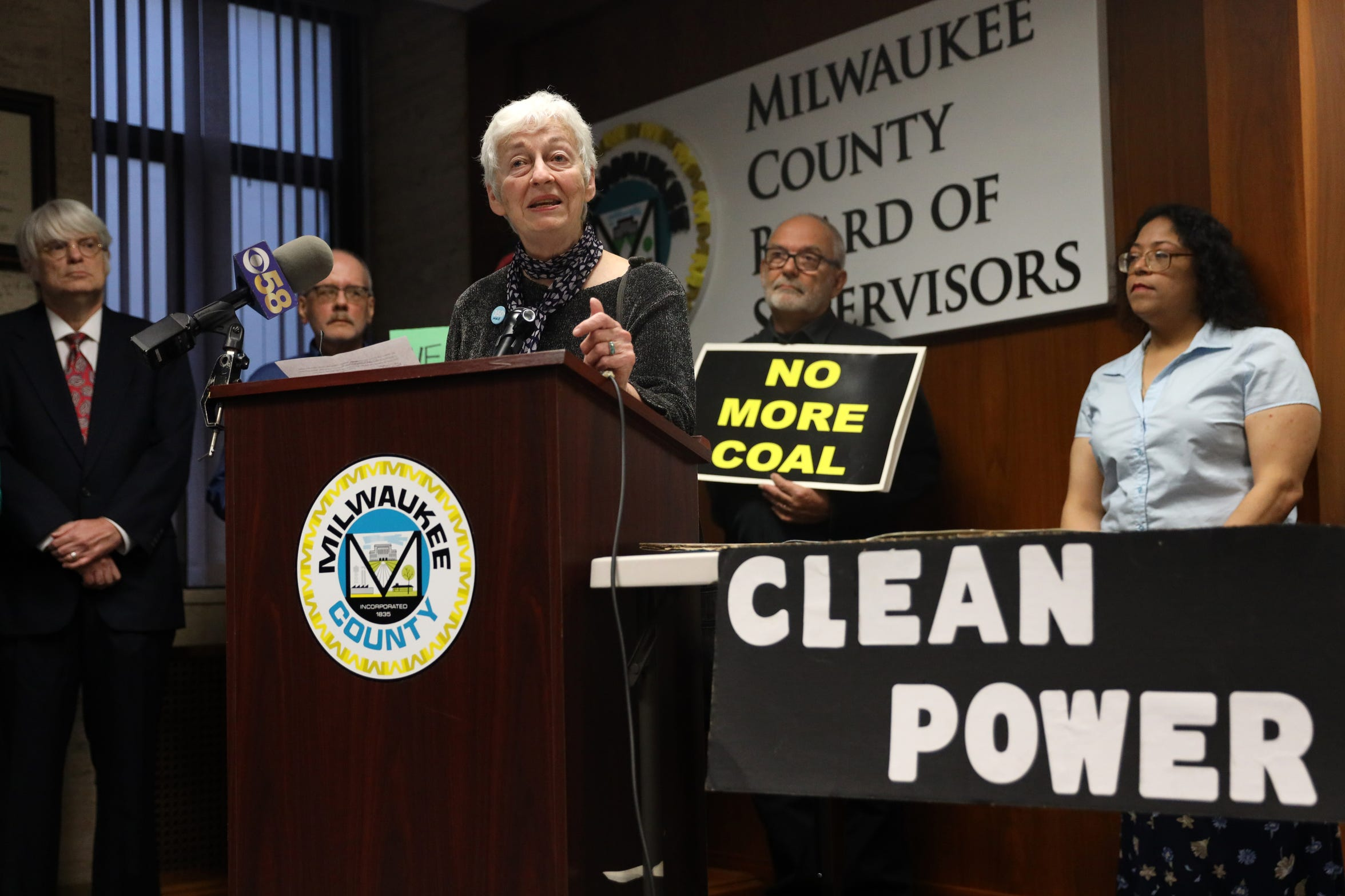 Julie Enslow from the Milwaukee chapter of 350.org, a climate-change advocacy group, speaks at a news conference hosted by the Sierra Club in Milwaukee on April 25, 2019. She and others oppose We Energies' request for a variance in the way mercury is measured in discharge water from the Oak Creek power plants near Milwaukee. Mercury is a well-known neurotoxin. The company says the variance will not increase emissions from the plant, but advocates fear it will.